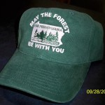 "Green hat with white embroidered ""May the Forest Be with You"" Logo"